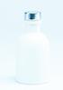 zwart flesje met gouden dopje